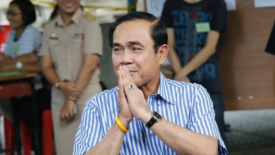 Thailand's Prime Minister Prayuth Chan-ocha leaves after casting his vote in a referendum on a new constitution at a polling station in Bangkok, Thailand, Sunday, Aug. 7, 2016. Thais voted Sunday in a referendum on a new constitution that critics say is tailor-made for the military government to stay in control for several years and entrench a new, quasi-democratic system that gives vast powers to appointed officials. (AP Photo/Sakchai Lalit)