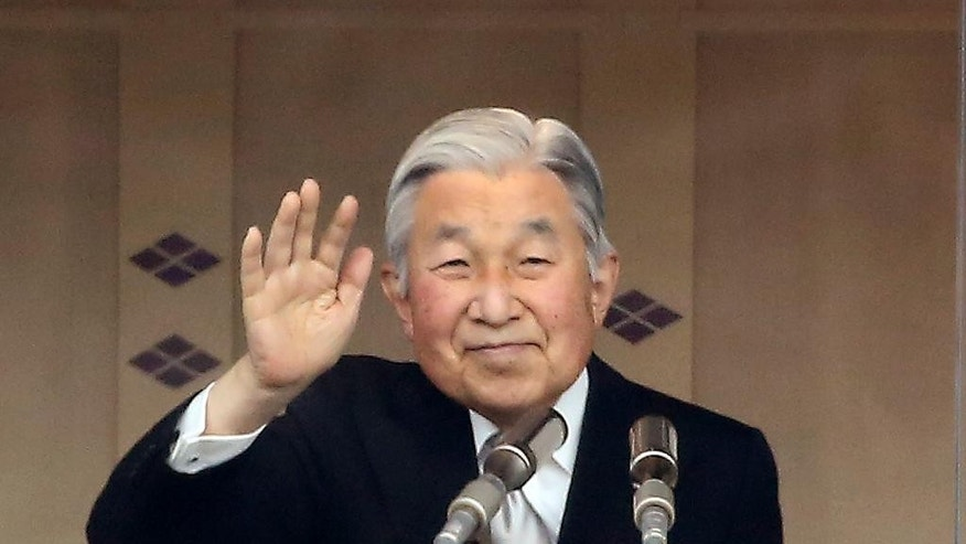 FILE - In this Dec. 23, 2015 file photo, Japan's Emperor Akihito waves to well-wishers as he appears on the balcony of the Imperial Palace to mark his 82nd birthday in Tokyo. Japanese emperor, in rare TV address aired on Monday, Aug. 8, 2016, says he is concerned about his ability to fulfill duties fully. (AP Photo/Eugene Hoshiko)