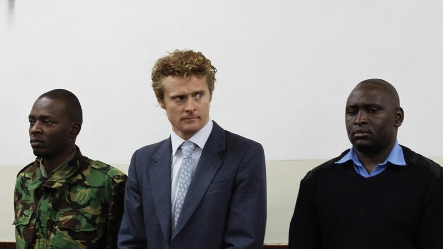 British national Jack Alexander Wolf Marrian, centre,  appears at Kibera Law Court in Nairobi, Kenya, Monday, Aug. 8, 2016. A Kenyan court has released on bond a British national charged with trafficking nearly 100 kilograms (220 pounds) of cocaine. Jack was to be released Monday on a bond equaling $690,000, with two Kenyan sureties of similar amount. (AP Photo/Khalil Senosi)