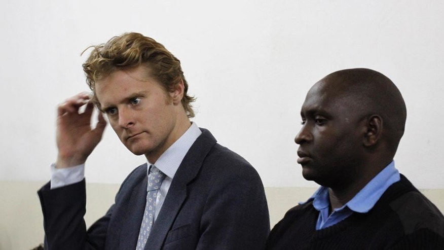 British national Jack Alexander Wolf Marrian, left, appears at Kibera Law Court in Nairobi, Kenya, Monday, Aug. 8, 2016. A Kenyan court has released on bond a British national charged with trafficking nearly 100 kilograms (220 pounds) of cocaine. Jack was to be released Monday on a bond equaling $690,000, with two Kenyan sureties of similar amount. (AP Photo/Khalil Senosi)