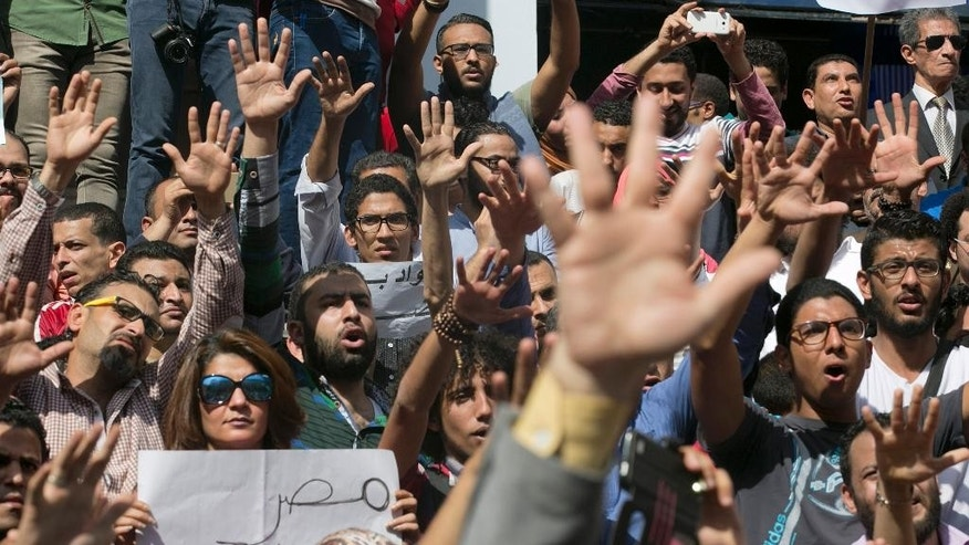FILE - In this April 15, 2016 file photo, Egyptians shout slogans against Egyptian President Abdel-Fattah el-Sissi during a protest against the decision to hand over control of two strategic Red Sea islands to Saudi Arabia in front of the Press Syndicate, in Cairo, Egypt. Three Egyptian dailies said Monday, Aug 8, 2016, that Cairo was proposing to IMF delegates an 18-month reform program in return for a $12 billion loan over three years to shore up its economy, but that differences remained between the two sides on how to proceed. Egypt is struggling to keep its economy afloat, amid a slump in tourism, foreign currency shortages and double digit inflation and unemployment. The government is also fighting an insurgency in the strategic Sinai Peninsula while continuing to show little tolerance for domestic political dissent. (AP Photo/Amr Nabil, File)