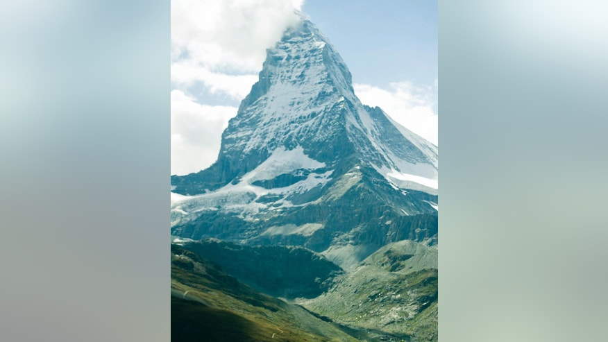 FILE -  A July 30 2011 file picture shows the famous Matterhorn mountain near Zermatt, Switzerland. A British mountaineer who climbed Switzerland's iconic Matterhorn say he is the first quadruple amputee to do so. Jamie Andrew lost his hands and feet to frostbite after becoming trapped in a snowstorm while mountaineering in France 17 years ago. (Jean-Christophe Bott/Keystone via AP, File)