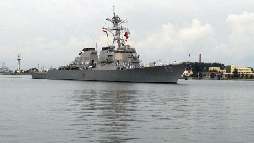The guided missile destroyer USS Benfold arrives in port in Qingdao in eastern China's Shandong Province, Monday, Aug. 8, 2016. A U.S. Navy guided missile destroyer arrived in the northern Chinese port of Qingdao on Monday in the first visit by an American warship to the country since Beijing responded angrily to an arbitration panel's ruling that its expansive South China Sea maritime claims had no basis in law. (AP Photo/Borg Wong)