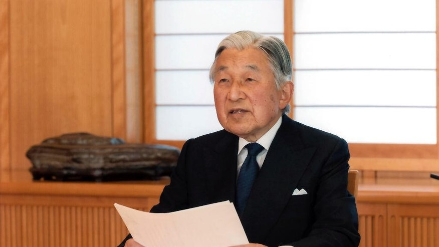 In this photo taken Sunday, Aug. 7, 2016 and provided by the Imperial Household Agency of Japan on Monday, Aug. 8, 2016, Japan's Emperor Akihito reads a message for recording at the Imperial Palace in Tokyo. Akihito expressed concern about fulfilling his duties as he ages in an address to the public in a 10-minute recorded speech broadcast on national television Monday that was remarkable for its rarity and its hinted possibility that he may want to abdicate in a few years. (Imperial Household Agency of Japan via AP)
