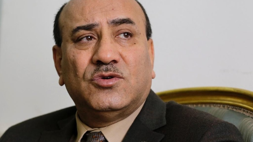 "FILE - In this  April 16, 2014 file photo, Hesham Genena, then head of Egypt's oversight body, speaks during an interview with the Associated Press at his office in Cairo. Human Rights Watch says the dismissal by Egypt's president of his country's top anti-graft official and his conviction of ""disseminating false news"" violated free speech and set a dangerous precedent. A court convicted Genena in July 2016 over a report he issued claiming that corruption has cost the country 600 billion pounds ($67.6 billion)  He escaped going to jail by paying a fine and has appealed the verdict. (AP Photo/Amr Nabil, File)"
