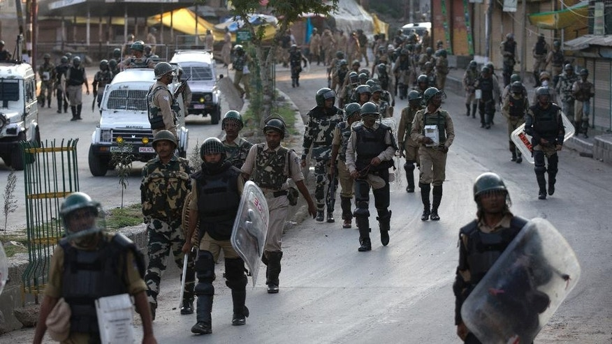 Indian paramilitary soldiers walk back towards their base camp after a day long curfew in Srinagar, Indian controlled Kashmir, Monday, Aug. 8, 2016. Kashmir has been under a security lockdown and curfew since the killing of a popular rebel commander on July 8 sparked some of the largest protests against Indian rule in recent years. (AP Photo/Dar Yasin)