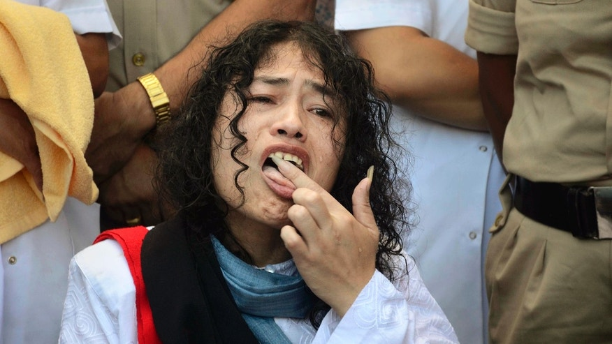 Indian political activist Irom Sharmila licks honey from her hand to break her fast.