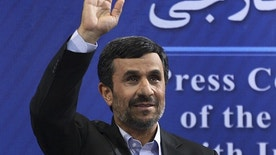 June 7: Iranian President Mahmoud Ahmadinejad waves to the media, as he arrives for his press conference, in Tehran, Iran.