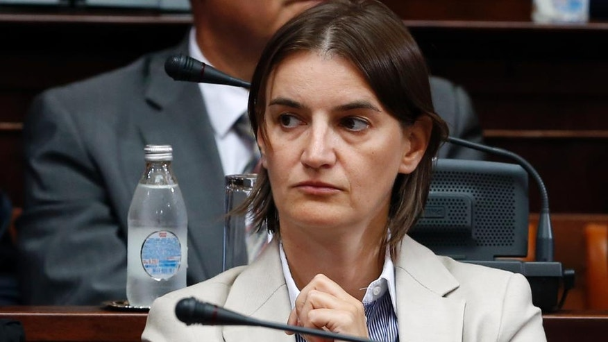 Serbian future Public Administration Minister Ana Brnabic gestures during the parliament session in Belgrade, Serbia, Tuesday, Aug. 9, 2016.  Serbia's prime minister-designate Aleksandar Vucic said that his new government will include new Public Administration Minister Ana Brnabic who does not hide her sexual orientation. (AP Photo/Darko Vojinovic)