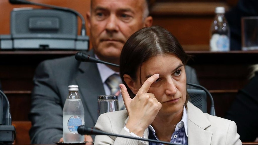 Serbian future Public Administration Minister Ana Brnabic gestures during the parliament session in Belgrade, Serbia, Tuesday, Aug. 9, 2016.  Serbia's prime minister-designate Aleksandar Vucic said that his new government will include new Public Administration Minister Ana Brnabic does not hide her sexual orientation. (AP Photo/Darko Vojinovic)