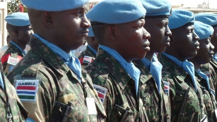 UN peacekeepers of the joint African Union-United Nations Mission in Darfur stand guard on January 16, 2012 in Darfur.