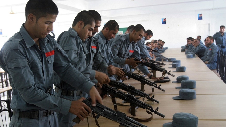 July 24, 2016: Afghan police soldiers practice, in Lashkargah, capital of southern Helmand province, Afghanistan