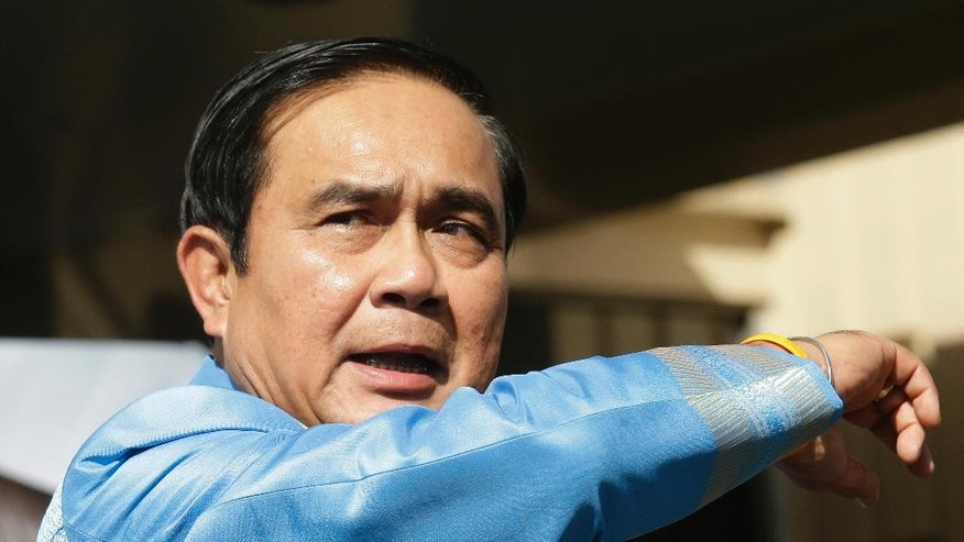 Thai Prime Minister Prayuth Chan-ocha gestures as arrives at the government house before a cabinet meeting in Bangkok, Thailand, Tuesday, Aug. 9, 2016. As he arrived, Prayuth explained that Sunday's referendum on the draft constitution, which won overwhelming approval, was part of the government's road map to political reforms and a bona fide democracy. (AP Photo/Sakchai Lalit)