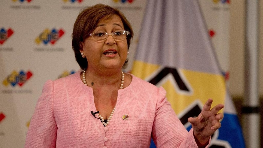 National Elections Council President Tibisay Lucena speaks during a televised nation wide speech, from her office in Caracas, Venezuela, Tuesday, Aug. 9, 2016. Venezuelan elections officials have set an October date for a recall drive against President Nicolas Maduro. (AP Photo/Fernando Llano)