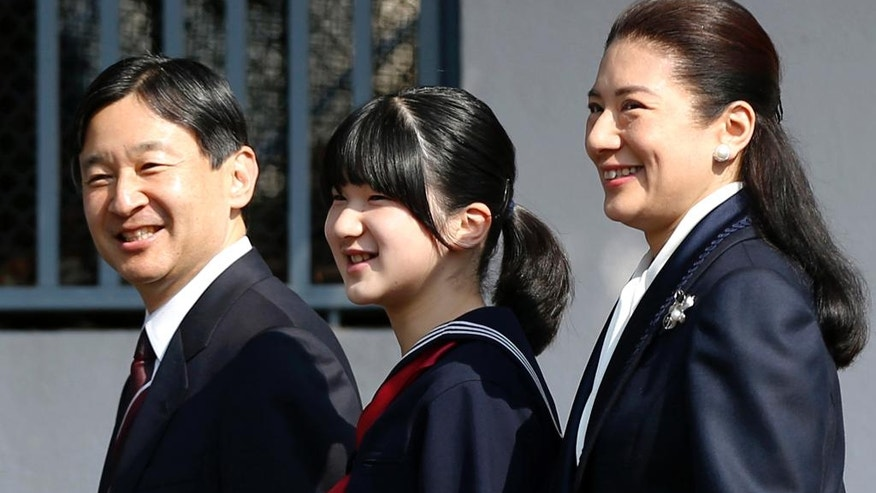 FILE -  In this March 18, 2014, file photo, Japan's Princess Aiko, center, accompanied by her parents Crown Prince Naruhito and Crown Princess Masako, arrives to attend her graduation ceremony at the Gakushuin Primary School in Tokyo. Emperor Akihito's video message on Monday, Aug. 8, 2016, though subtle, conveyed his wish to abdicate, and the attention now goes to his elder son Naruhito, the first in line to Japan's Chrysanthemum throne. Naruhito, 56, married to a Harvard-educated former diplomat Masako, who has been ill for more than a decade and seldom appears in public. But she is better known abroad and his presence is often eclipsed whenever she comes out. (Toru Hanai/Pool Photo via AP, File)