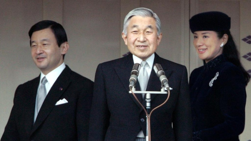 FILE - In this Dec. 23, 2007, file photo, Japan's Emperor Akihito, center, stands as Crown Prince Naruhito and his wife Crown Princess Masako enter a bulletproof balcony at Imperial Palace in Tokyo for a public appearance by the emperor. Akihito's video message Monday, Aug. 8, 2016, though subtle, conveyed his wish to abdicate, and the attention now goes to his elder son, Naruhito, the first in line to Japan's Chrysanthemum throne. (AP Photo/Shizuo Kambayashi, File)