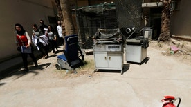 Burnt incubators stand outside a maternity ward after a fire broke out at Yarmouk hospital in Baghdad, Iraq, August 10, 2016. REUTERS/Thaier Al-Sudani - RTSMBPO