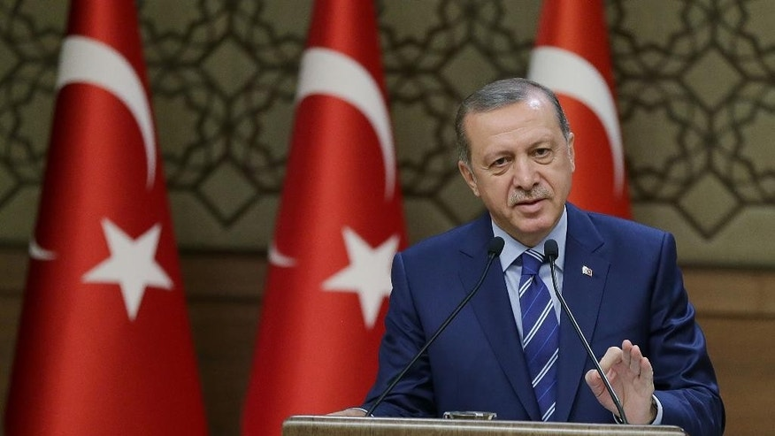 Turkish President Recep Tayyip Erdogan delivers a speech in Ankara, on Wednesday, Aug. 10, 2016. Erdogan has called on a group of businessmen to inform authorities about anyone they suspect of being a follower of a U.S.-based Muslim cleric accused of orchestrating Turkey's failed July 15 coup. (Presidential Press Service via AP)