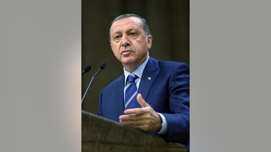 Turkish President Recep Tayyip Erdogan delivers a speech to a group of export businessmen in Ankara, on Wednesday, Aug. 10, 2016. Erdogan has called on a group of businessmen to inform authorities about anyone they suspect of being a follower of a U.S.-based Muslim cleric accused of orchestrating Turkey's failed July 15 coup. (Presidential Press Service via AP)