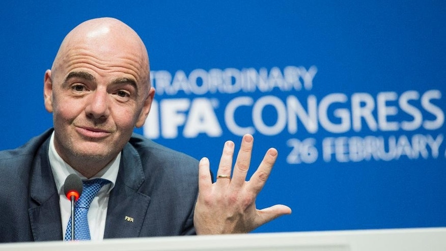 FILE - In this Feb. 26, 2016 file photo Swiss Gianni Infantino, then new FIFA President, smiles during the press conference after being elected, at the Extraordinary FIFA Congress 2016 in Zurich, Switzerland. FIFA's ethics committee has cleared Infantino of alleged misconduct relating to use of private flights. FIFA ethics prosecutors say their decision to end a formal investigation into alleged conflicts of interest and improperly accepting gifts was supported by FIFA ethics judges. ( Ennio Leanza/Keystone via AP, File)