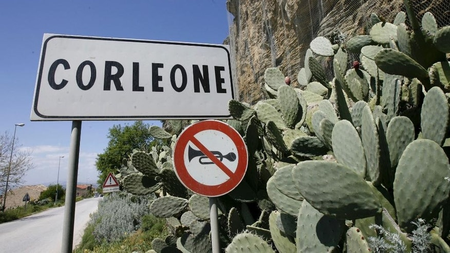 "FILE -- In this file photo taken on April 12, 2006, a road sign announces the town of Corleone, Italy. Premier Matteo Renzi's Cabinet dissolved Corleone's municipal government because  of Mafia infiltrations and put its City Hall under temporary control of the interior ministry. Corleone is the Sicilian town inspiring the fictional crime clan's name in ""The Godfather"" novel and movie. (AP Photo/Luca Bruno)"