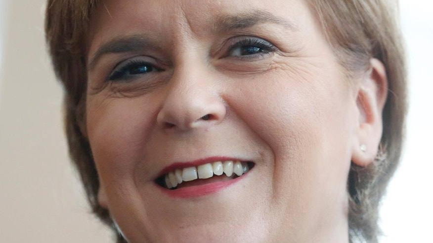 FILE - In this Thursday, July 30, 2015, file photo, First Minister of Scotland Nicola Sturgeon smiles during the opening ceremony of the Scotland Hong Kong Centre for Carbon Innovation in Hong Kong. On Tuesday, Sturgeon says Scotland should be able to remain part of the European Union without leaving the United Kingdom. (AP Photo/Kin Cheung, File)