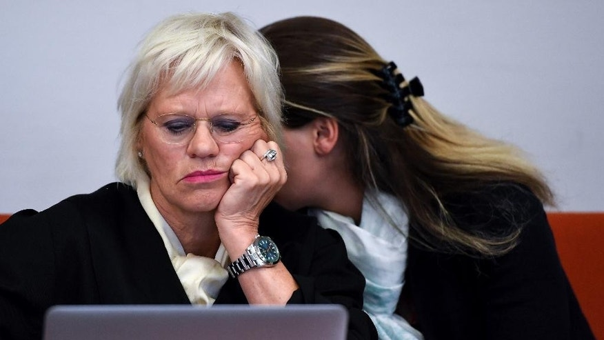 FILE -In this Aug. 3, 2016 file  picture Malanie M., right, sits in the courtroom in Munich, Germany next to her lawyer Annette Voges, left.  The  woman has been convicted of  attempted manslaughter for stabbing a visitor to Munich's Oktoberfest who racially abused a former Germany soccer player with whom she was attending the  beer festival. She was sentenced to 4 ½ years in prison. The stabbing happened last September  after a truck driver racially insulted former Germany player Patrick Owomoyela  and threatened the 34-year-old defendant, a Hamburg millionaire's fiancee. (Sven Hoppe/dpa via AP,file)