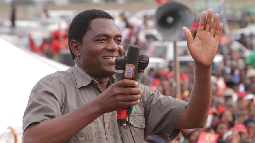 FILE -- In this Jan. 2015 file photo Hakainde Hichilema, of the Zambia opposition United Party for National Development addresses an election rally in Lusaka, Zambia. This southern African country votes in a presidential election Thursday Aug. 11, 2016, amid widespread concerns about possible political violence as President Edgar Lungu faces off against businessman contender Hakainde Hichilema.  (AP Photo/Tsvangirayi Mukwazhi, File)