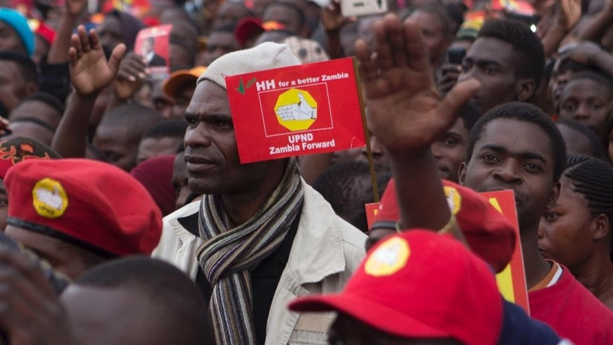 "Supporters of the United Party for National Development opposition party attend an election rally on the eve of the country's presidential elections in Lusaka, Zambia, Wednesday, Aug. 10, 2016. This southern African country votes Thursday amid concerns about political violence after years of peaceful power transitions that the U.S. last year praised as a ""model for Africa."" (AP Photo/Moses Mwape)"
