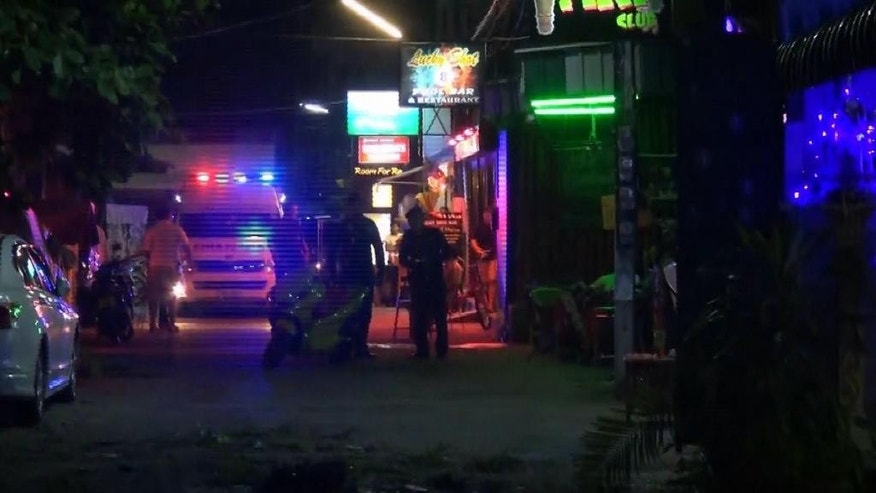In this screen grab taken from video, emergency services at the scene of a bomb attack, in Hua Hin, Thailand, Thursday, Aug. 11, 2016. Two small bombs exploded Thursday night in Thailand's popular seaside resort town of Hua Hin, leaving at least one person dead and 20 others injured, according to Thai media. (AP)