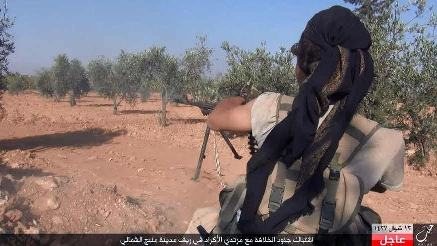 "his image posted online on Monday, July 18, 2016, by supporters of the Islamic State militant group on an anonymous photo sharing website, shows an Islamic State fighter fires his weapon during clashes with the Kurdish-led Syria Democratic Forces in Manbij, in Aleppo province, Syria. The Arabic caption on the photo reads, ""Soldiers of the caliphate clash with Kurdish infidels in northern countryside of Manbij."" (militant photo via AP)"