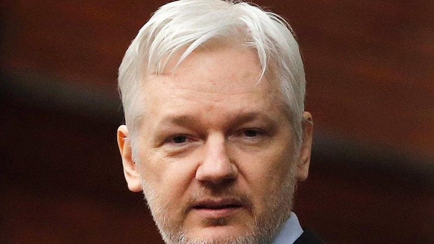 FILE - In this Feb. 5, 2016, file photo, WikiLeaks founder Julian Assange stands on the balcony of the Ecuadorean Embassy in London. Ecuador says it's ready to set a date for Swedish prosecutors to question Assange, who has been holed up in the South American country's embassy in London for four years. Assange is wanted for questioning by Swedish police over rape allegations stemming from his visit to the country in 2010. (AP Photo/Frank Augstein, File)
