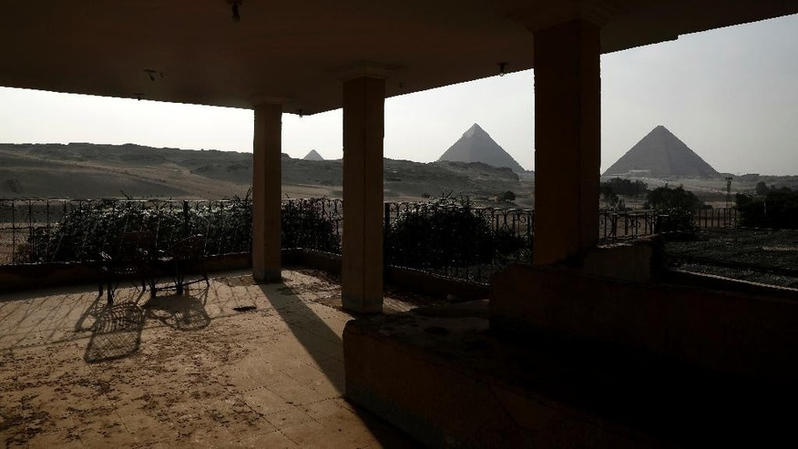 This Monday, Aug. 8, 2016 photo shows a general view of a coffee shop that ran out of business near the Giza Pyramids. Egypt's economy has been struggling since the 2011 uprising that overthrew longtime autocrat Hosni Mubarak, with high inflation, foreign currency shortages, and lack of tourism and investment that has hit both business and the broader population's well-being. (AP Photo/Nariman El-Mofty)