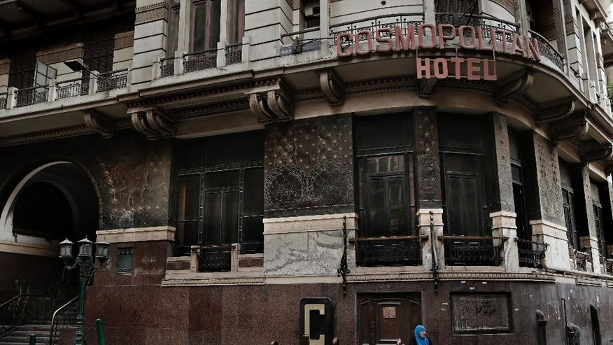 In this Wednesday, Aug. 9, 2016 photo, a woman sits on the corner of a hotel with low occupancy in downtown Cairo, Egypt. The International Monetary Fund said it signed an initial agreement with Egypt on Thursday, Aug. 11, 2016 to loan the Middle Eastern country $12 billion over three years to help fix its ailing economy. Egypt's economy has been struggling since the 2011 uprising that overthrew longtime autocrat Hosni Mubarak, with high inflation, foreign currency shortages, and lack of tourism and investment that has hit both business and the broader population's well-being. (AP Photo/Nariman El-Mofty)