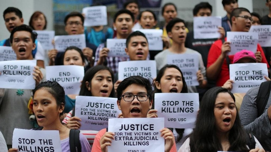 "Filipino student activists shout slogans as they call for justice for victims of extrajudicial killings during a rally at the University of the Philippines in suburban Quezon city, north of Manila, Philippines, Thursday Aug. 11, 2016. The group protested the hundreds of mostly poor victims of the extrajudicial killings around the country in the wake of the ""War on Drugs"" campaign by Philippine President Rodrigo Duterte. (AP Photo/Aaron Favila)"