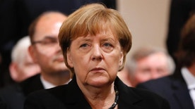 German chancellor Angela Merkel attends a memorial service for the nine victims of a shooting at the Olympia shopping center in Munich, Germany, Sunday, July 31, 2016. An 18-year-old German-Iranian man killed nine people and wounded over 30 others  on July 22, at a McDonald's restaurant and shopping mall in the city. He then killed himself.  ( (AP Photo/Matthias Schrader)