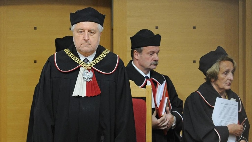 Andrzej Rzeplinski, left, head of Poland's Constitutional Court and judges enter the courtroom to attend a session at the Constitutional Tribunal in Warsaw, Poland, Thursday, Aug. 11, 2016. The tribunal has ruled that parts of a new law governing its own operation are unconstitutional, what is the latest development in a nine-month saga centered on Poland's highest legislative court. (AP Photo/Alik Keplicz)
