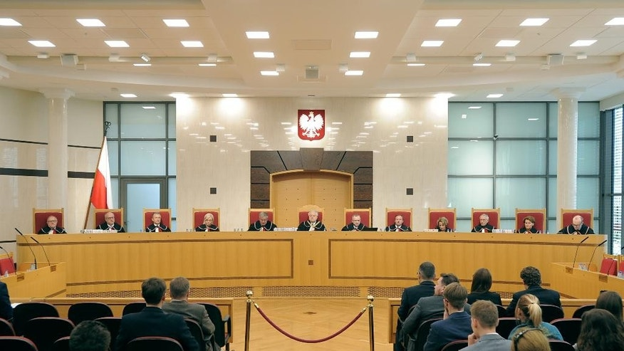 Judges attend a session at the Constitutional Tribunal in Warsaw, Poland, Thursday, Aug. 11, 2016. The tribunal has ruled that parts of a new law governing its own operation are unconstitutional, what is the latest development in a nine-month saga centered on Poland's highest legislative court. (AP Photo/Alik Keplicz)