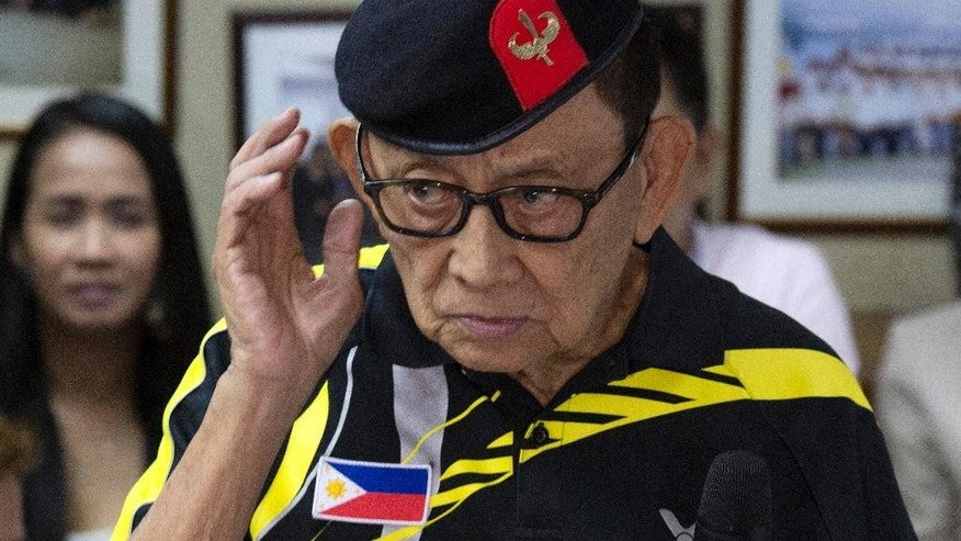 FILE - In this Aug. 9, 2016 file photo, former Philippine President Fidel Ramos listens to a question during a press briefing at the Philippines consular office in Hong Kong. Ramos says China has welcomed him to come to Beijing for discussions in the wake of July 12 international arbitration panel's ruling in favor of the Philippines over China's South China Sea maritime claims.  (AP Photo/Ng Han Guan, File)