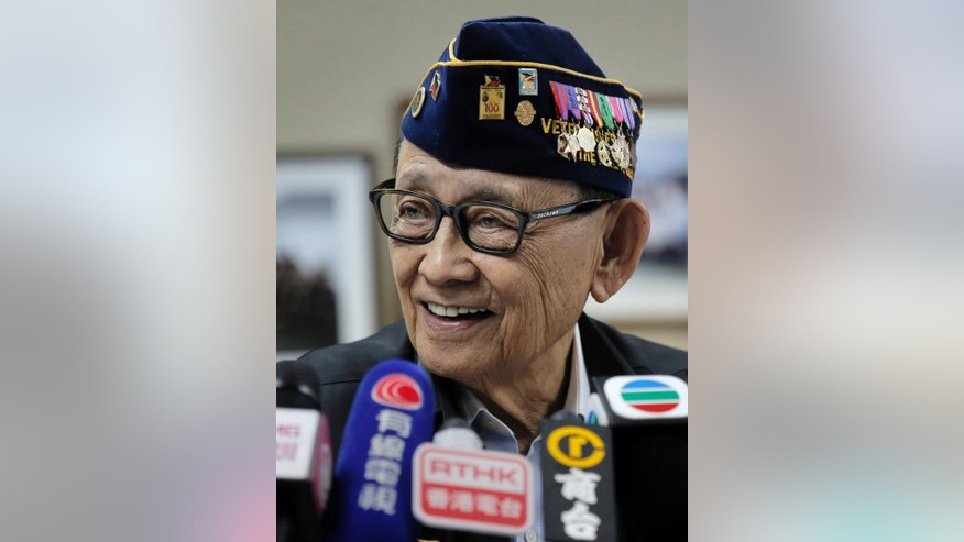 Former Philippine President Fidel Ramos smiles during a press briefing at the Philippines consular office in Hong Kong, China Friday, Aug. 12, 2016. Ramos said Friday that China has welcomed him to visit Beijing for discussions in the wake of last month's international arbitration panel's ruling in favor of the Philippines over China's South China Sea maritime claims. (AP Photo/Vincent Yu)