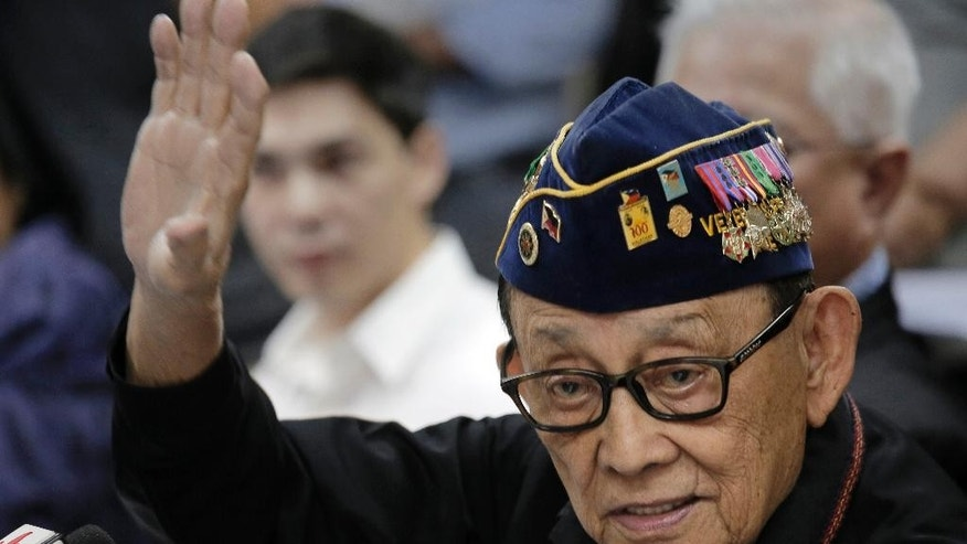Former Philippine President Fidel Ramos gestures during a press briefing at the Philippines consular office in Hong Kong, China, Friday, Aug. 12, 2016. Ramos said Friday that China has welcomed him to visit Beijing for discussions in the wake of last month's international arbitration panel's ruling in favor of the Philippines over China's South China Sea maritime claims. (AP Photo/Vincent Yu)
