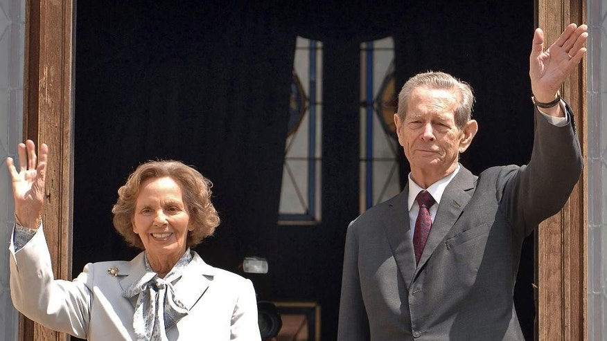 FILE - In this Thursday, June 5, 2008 file photo, former Romanian King Michael I, right, and his wife Anne, left, wave from the balcony of the Peles Castle, in Sinaia, Romania. Romania's royal house says former King Michael, who has cancer, will miss his wife's funeral on the advice of medics. The Royal House said Monday, Aug. 8, 2016, five doctors had recommended that Michael, 94, not travel to Romania to attend the Aug. 13 funeral of Anne of Romania, his wife of 68 years. (AP Photo/Paul Buciuta, File)