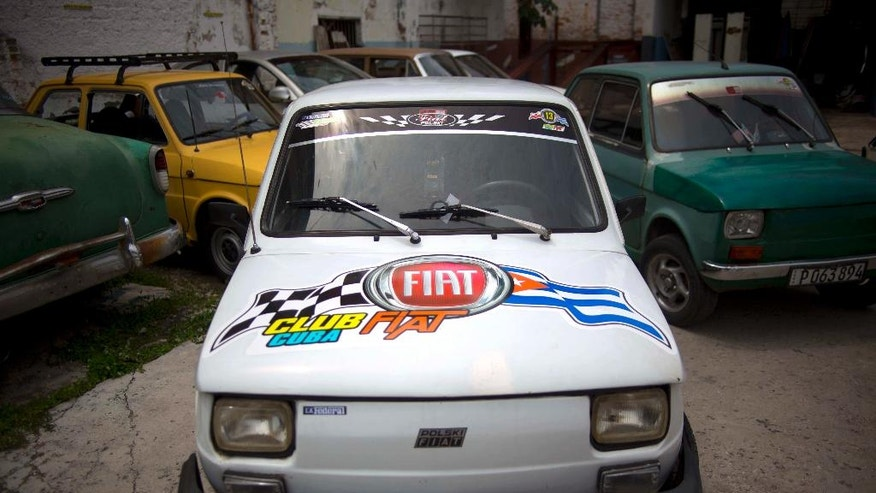 Fiat Polski 126p's from the Club Fiat Cuba, stand in a garage in Havana, Cuba, Tuesday, August 10, 2016. The half-ton, two-cylinder Polish-made hatchback, the Fiat 126p was forgotten by most people after the fall of the Berlin Wall. Decades later, the car lovingly known as the Polski is basking in a Cuban revival.  (AP Photo/Ramon Espinosa)