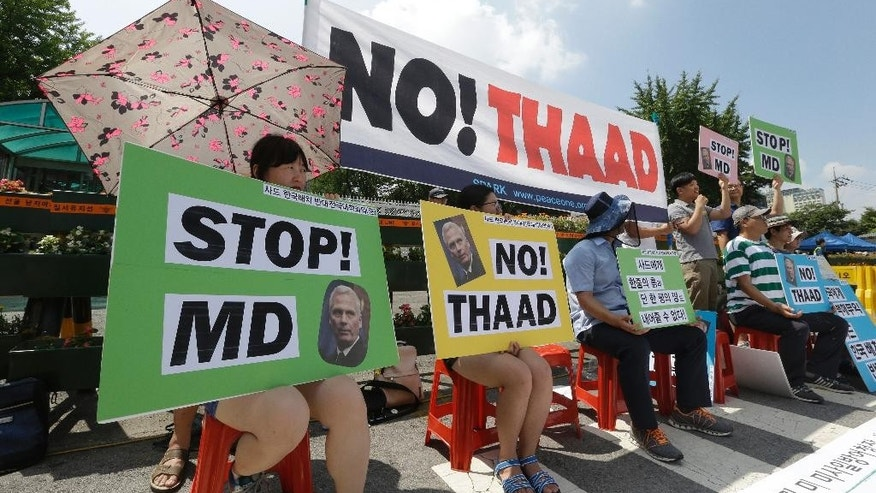South Korean protesters stage a rally opposing a plan to deploy an advanced U.S. missile defense system in the country called Terminal High-Altitude Area Defense, or THAAD, in front of the Defense Ministry in Seoul, South Korea, Thursday, Aug. 11, 2016. James Syring, director of the U.S. Missile Defense Agency, arrived on Thursday to meet with South Korean officials on the deployment of THAAD. The need for and safety of THAAD are still being debated in South Korea after the government decided in early July to install it as a defensive measure against threats from North Korea. (AP Photo/Ahn Young-joon)