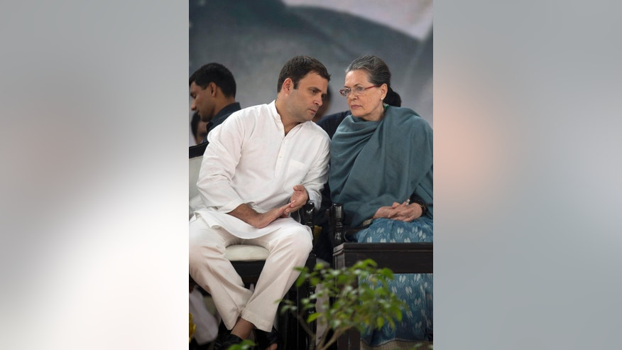 FILE- In this Nov. 14, 2015, file photo, Congress party President Sonia Gandhi, right, listens to her son and party Vice President Rahul Gandhi during celebrations marking the birth anniversary of the first Indian Prime Minister Jawaharlal Nehru in New Delhi, India. Following a string of stinging electoral defeats, the 131-year old Congress party - which has led India for nearly three-fourths of its modern history - is foundering. Several senior leaders have quit the party, accusing its leadership of failing to connect with the masses. And the blame is increasingly falling on the Gandhis, the family that has commanded the Congress party since its inception. (AP Photo/Tsering Topgya, File)