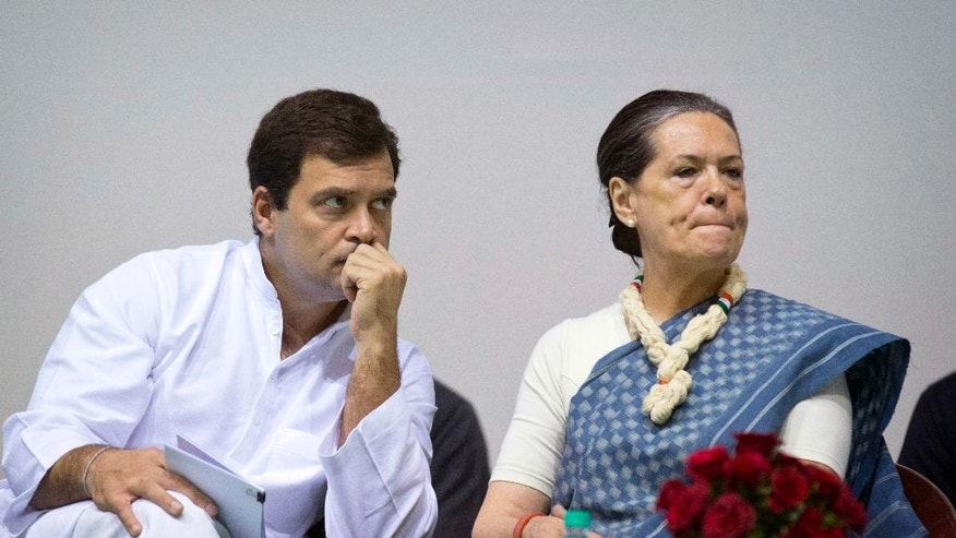 FILE - In this Nov. 13, 2014, file photo, Congress party President Sonia Gandhi, right, and her son and Vice President Rahul Gandhi listen to a speaker during celebrations marking the 125th birth anniversary of the first Indian Prime Minister Jawaharlal Nehru in New Delhi, India. Following a string of stinging electoral defeats, the 131-year old Congress party - which has led India for nearly three-fourths of its modern history - is foundering. Several senior leaders have quit the party, accusing its leadership of failing to connect with the masses. And the blame is increasingly falling on the Gandhis, the family that has commanded the Congress party since its inception. (AP Photo/Saurabh Das, File)