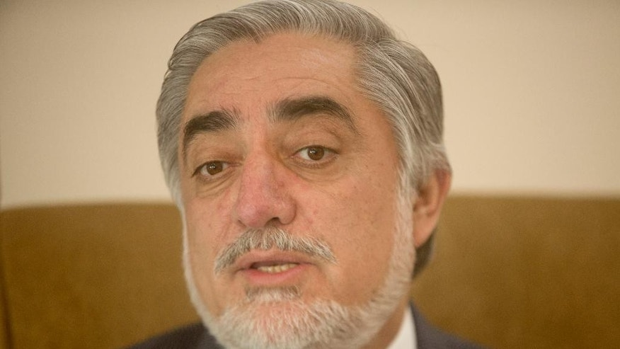 In this Monday, Aug. 8, 2016 photo, Afghanistan's chief executive Abdullah Abdullah talks during an interview with the Associated Press at his office in Kabul, Afghanistan. Key allies of Afghanistan's chief executive are threatening to withdraw their support for the government unless the country's president meets their camp's key demands. (AP Photos/Massoud Hossaini)
