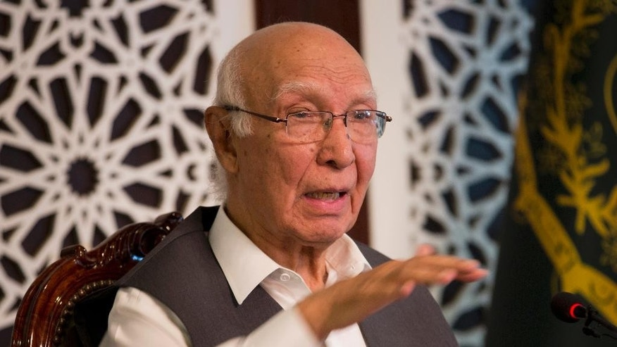 Pakistani prime minister's adviser on foreign affairs Sartaj Aziz addresses a news conference in Islamabad, Pakistan, Friday, Aug. 12, 2016. Aziz is hoping that months-long stalled four-nation peace process aimed at ending the war between Kabul and the Taliban could be revived in coming weeks. He told reporters Friday the lingering violence in Afghanistan could only end through revival of peace talks. (AP Photo/B.K. Bangash)
