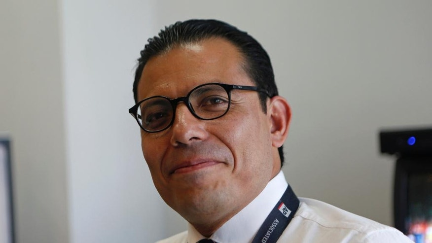 In this July 11, 2016 photo, Associated Press acting bureau chief for Mexico and Central America Eduardo Castillo, poses for a portrait at the AP offices in Mexico City. Castillo, a veteran reporter and news manager, has been appointed Deputy News Director for Production in Latin America and the Caribbean. In his new role, Castillo will oversee text, photo and video editors and translators in Mexico City, Madrid, Washington, New York and elsewhere. (AP Photo/Dario Lopez-Mills)