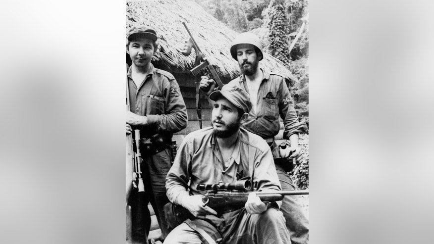 FILE - In this March 14, 1957 file photo, Fidel Castro, the young anti-Batista guerrilla leader, center, is seen with his brother Raul Castro, left, and Camilo Cienfuegos, right, while operating in the Mountains of Eastern Cuba. The man who nationalized the Cuban economy and controlled of virtually every aspect of life on the island celebrates his 90th birthday on Saturday. Aug. 13, 2016, in a far different country than the one he ruled for decades. (AP Photo/Andrew St. George, File)